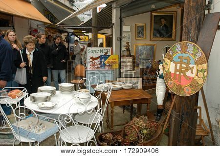 People Shopping At The Flea Market Of Clignancourt At Paris