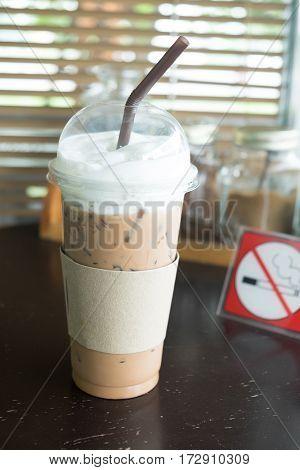 Ice cappuccino coffee on coffee table in coffee shop.