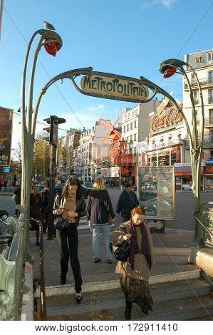 People Walking To The Metropolitan Sation Of Pigalle In Paris