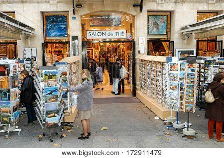 People Shopping At A Souvenir Shop Of Paris