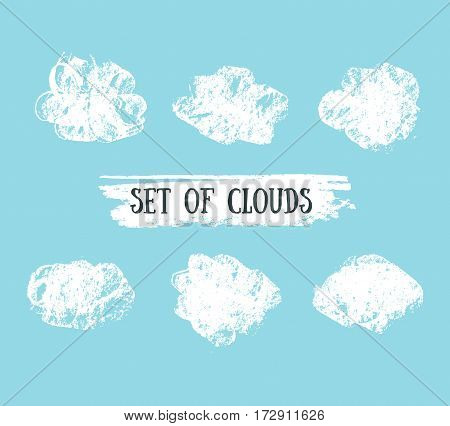 Collection of hand drawn vector grunge clouds on the blue background. Vector illustration.