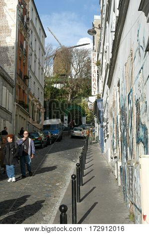 People Waking At The Neighborhood Of Monmartre In Paris
