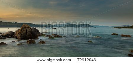 A rocky moss covered coastline looking out over the south China sea in Vung Lam Bay Vietnam.