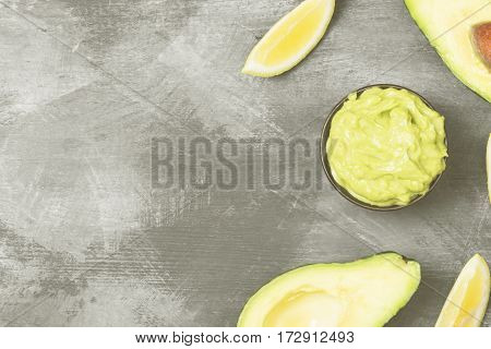 Traditional Latin American Sauce Guacamole In A Bowl And Ripe Avocados And Lemons On A Dark Backgrou