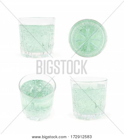 Rocks old fashioned glass filled with the carbonated green lemonade water isolated over the white background, set of four different foreshortenings