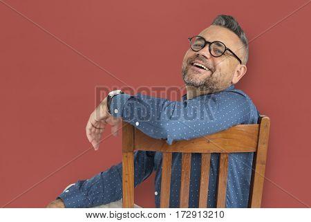 Casual Caucasian Man Sitting Smiling