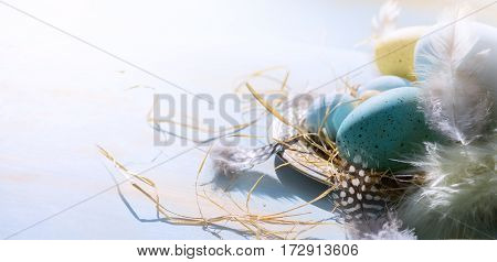 Easter background with Easter eggs on blue table