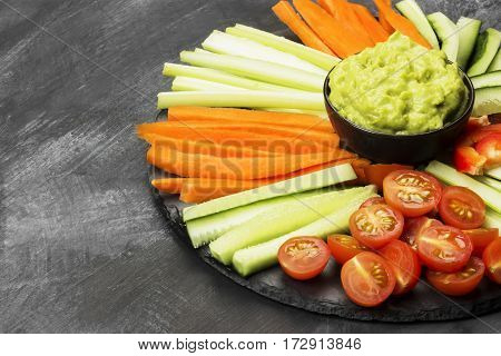 Traditional Latin American Sauce Guacamole In A Bowl And Various Vegetables (carrots, Tomatoes, Cucu