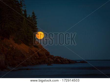 Full moon on the coast of  prince edward island