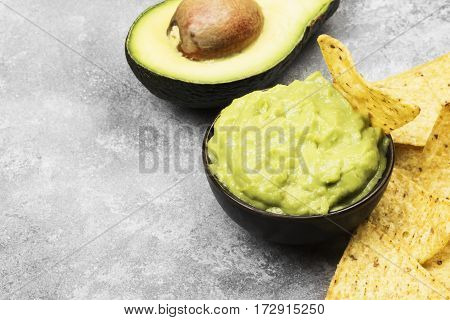 Traditional Latin American Sauce Guacamole In A Bowl And Nachos. Copy Space. Food Background