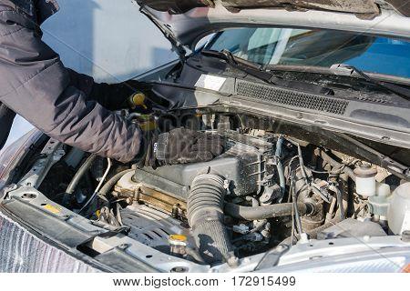 The master repairs the car. The car broke