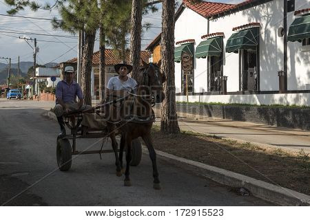 people on horse cart in town of Havana, Cuba, 2016.