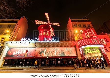 Paris France - MARCH 15 2015: The Moulin Rouge by night. Paris. France. Moulin Rouge is a famous cabaret locating in the Paris red-light district of Pigalle. Travel (vacation) concept.