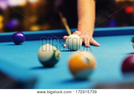 bar billiard - hand aiming the cue ball