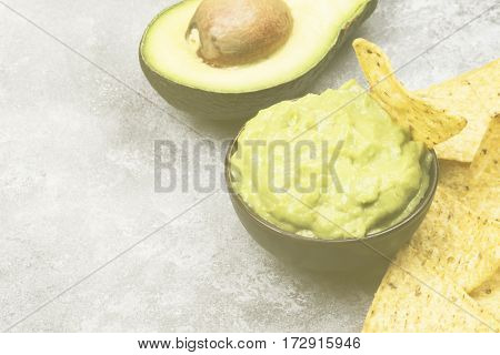 Traditional Latin American Sauce Guacamole In A Bowl And Nachos. Copy Space. Food Background. Toning