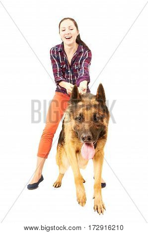 Beautiful young cheerful woman holds on a lead German Shepherd, isolated on white background
