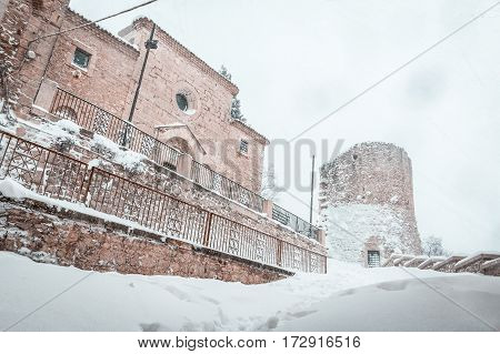 the snowy church and tower in Campobasso