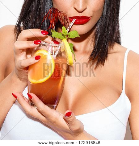 Woman drinking sex on the beach cocktail closeup