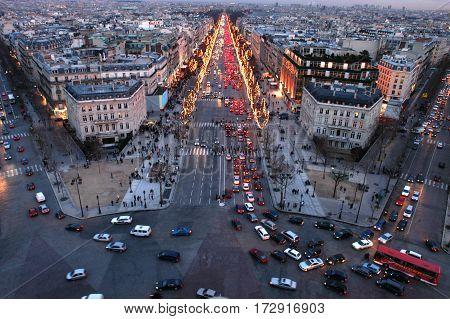 Paris, France - 26 December 2002: Sunset at Champ Elysee on Paris, France