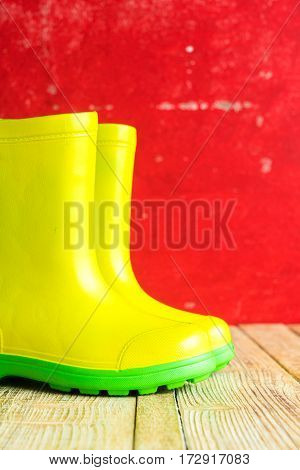 Gumboots on red wooden old background wall