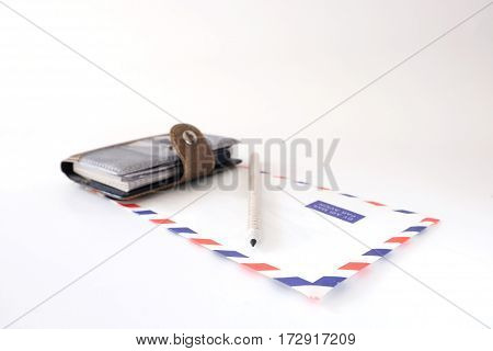 notebook envelope pencil on a white background isolated