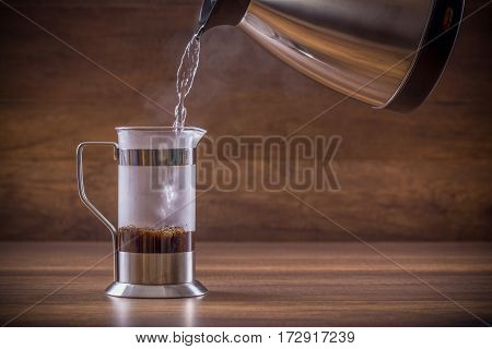 Pouring the hot water into the french press glass