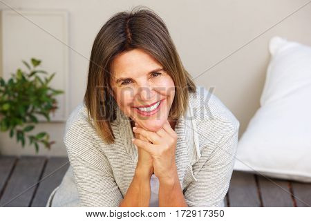 Smiling Older Woman Sitting Outside
