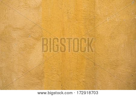 Close-up Yellow Concrete Wall Background. Texture Background.