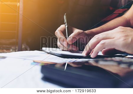 Woman Hands Writing Note At Home And Calculate Finance.