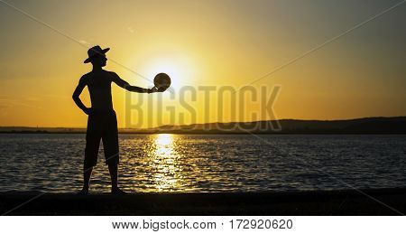 Website banner of a young man silhouette at sunset