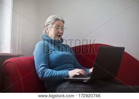 Elderly woman using technology