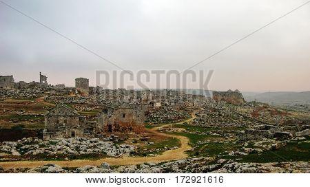 Panorama of ruined abandoned dead city SerjillaSyria