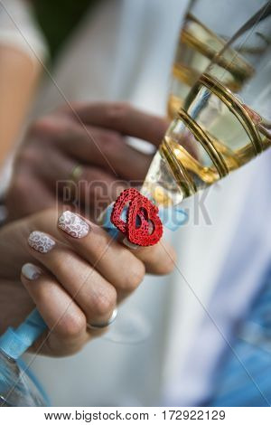 Wine-glasses with champagne on wedding day with beautiful heart.
