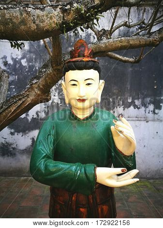 Close up of wooden Buddha statue in Vietnam