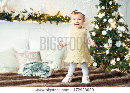 The little girl is a hare on the background trees. Merry Christmas.
