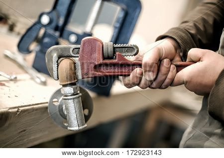 Carpenter Using Plier For His Job In Carpentry Workshop