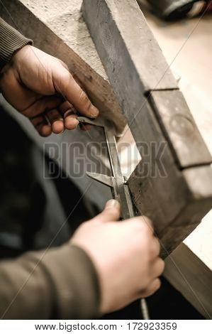 Carpenter Using Ruler For His Job In Carpentry Workshop