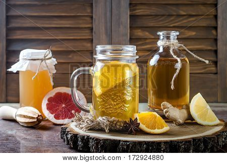 Homemade fermented raw kombucha tea with different flavorings. Healthy natural probiotic flavored drink. Copy space