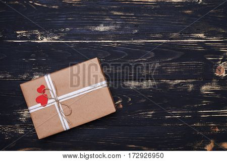 Top view of pretty present box tied with rope isolated on the shabby flat lay background