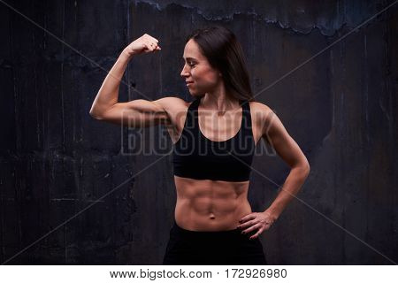 Close-up of slim athletic female performing effective bicep workout . Biceps concept. Fitness sport training lifestyle. Wearing sportswear for trainings