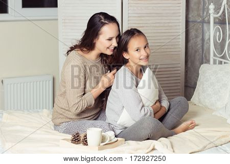 Mom And Daughter Secretive. Mom And Daughter Resting On The Bed. Good Morning. Cozy Fall. Winter.