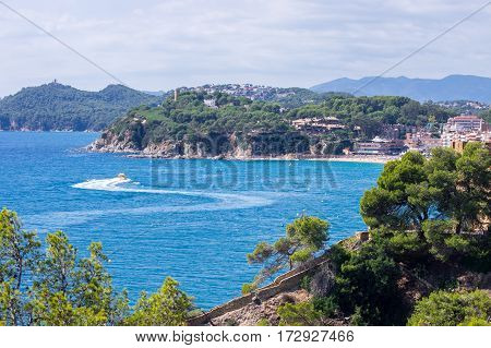 The motor boat heading to the land in Lloret de mar, Girona, Catalonia, Spain