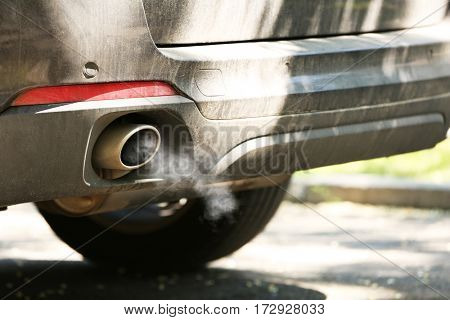 Combustion gas from car exhaust pipe, closeup