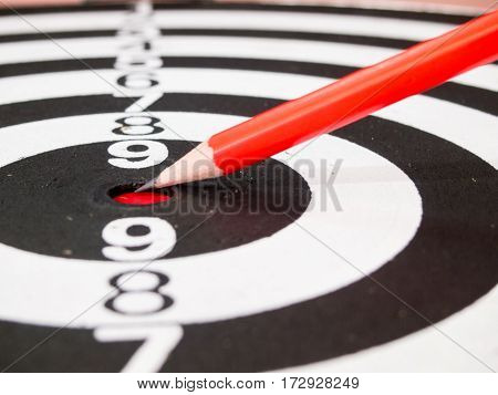 Black and white dart with the pencil point at the center (Concept for target achievement business focus)