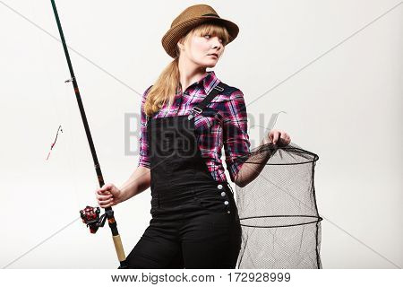 Happy Woman Holding Fishing Rod And Keepnet