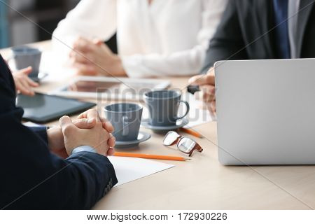 Business meeting concept. Male hands on table