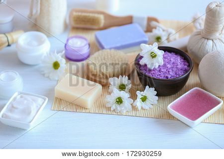 Spa treatments on white table in salon