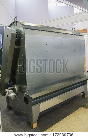 Industrial machine - big iron box for agricultural manufactory. Modern industries, close up