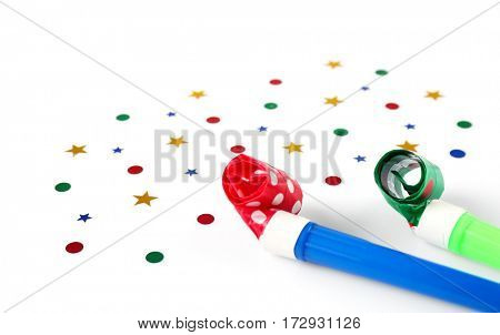 Bright confetti with festive fifes on white background