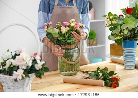 Young florist at workplace, close up view